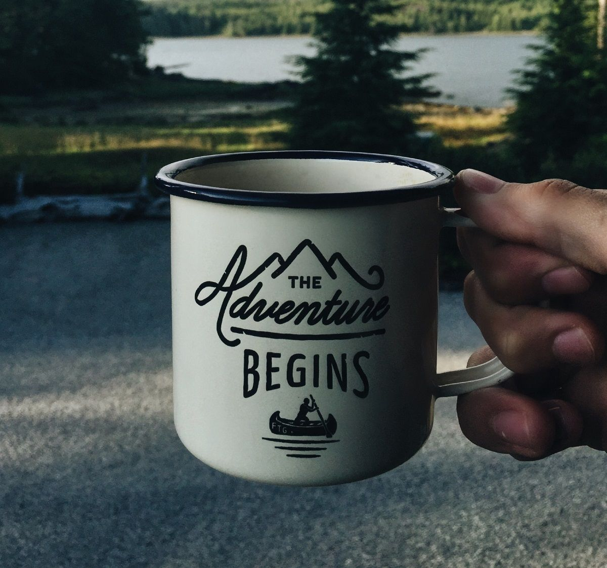Image of coffee cup with The Adventure Begins text